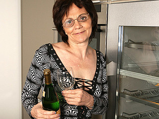 Horny older slut can't live out of masturbating during the time that drinking champagne
